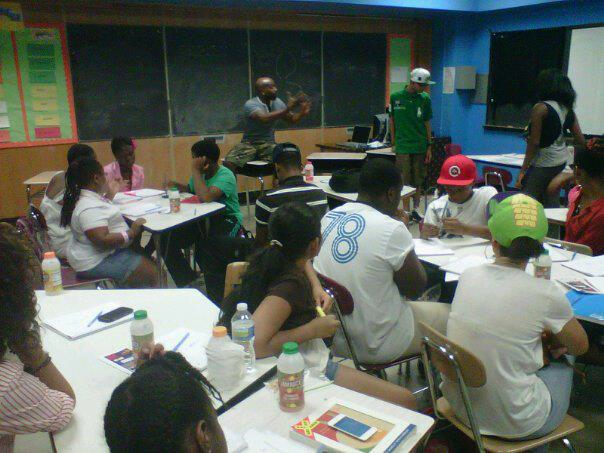 Kel Spencer instructing students during a Pens of Power Workshop