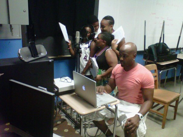 Kel working with students during a recording session during a workshop